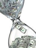 El tiempo es oro. Inflación. Reloj de arena y dólar. Imagen de archivo libre de regalías