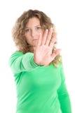 El tiranizar: Mujer rubia que hace gesto de la parada Foto de archivo