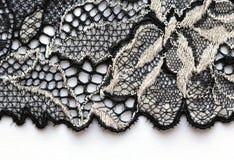 El tiro macro del material blanco y negro de la textura del cordón Fotos de archivo