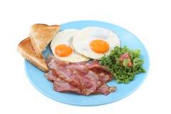 El tocino y los huevos desayunan aislado Fotografía de archivo