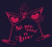 El ` todo lo que usted necesita es cartel del ` del amor con dos vidrios y corazones de martini Fotografía de archivo