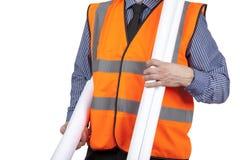 El topógrafo del edificio en la construcción que lleva del chaleco anaranjado de la visibilidad planea Fotografía de archivo