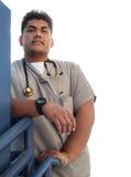 El trabajador de sexo masculino fuerte de la atención sanitaria hizo excursionismo por el sol Imagen de archivo libre de regalías