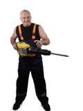 El trabajador fuerte con el sacador Foto de archivo libre de regalías