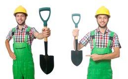 El trabajador industrial con la pala aislada en blanco fotos de archivo libres de regalías