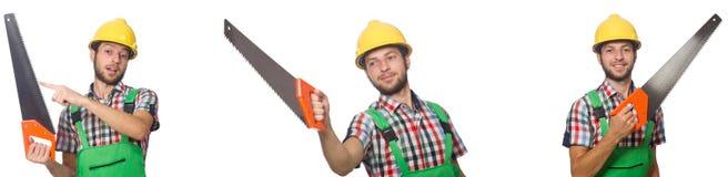 El trabajador industrial con la sierra aislada en blanco fotos de archivo