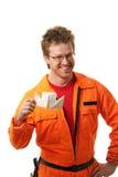 El trabajador se sostiene juguete-expide construido de un papel imágenes de archivo libres de regalías