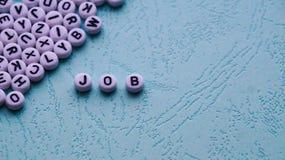 El trabajo de la palabra se hace de bloques plásticos redondos Fotografía de archivo