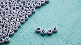 El trabajo de la palabra se hace de bloques plásticos redondos Foto de archivo libre de regalías
