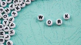 El trabajo de la palabra se hace de bloques plásticos redondos Foto de archivo