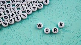 El trabajo de la palabra se hace de bloques plásticos redondos Fotografía de archivo libre de regalías