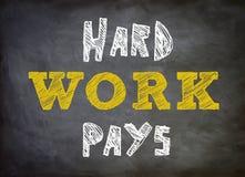 El trabajo duro paga Imagen de archivo libre de regalías