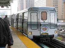 El Train. The Detroit People Mover arriving at the busy station in downtown Detroit Stock Image