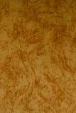 El umber ligero y la pared de mármol marrón de la teja texturizan el fondo Imagenes de archivo