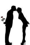 El un besarse del hombre y de la mujer de los pares Fotografía de archivo