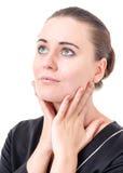 El uso de los cosméticos para el cuidado de piel Imágenes de archivo libres de regalías