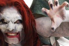 El vampiro femenino tiene gusto de la criatura Imágenes de archivo libres de regalías