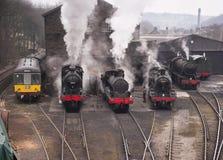 El vapor entrena en fila Imagen de archivo