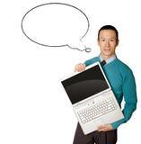 El varón en azul con la computadora portátil y los tebeos burbujean Imagenes de archivo