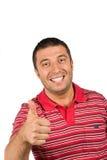 El varón feliz da el pulgar para arriba Foto de archivo