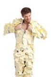 El varón joven cubierto con las etiquetas engomadas amarillas Imagenes de archivo