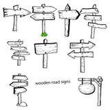 El vector del ejemplo garabatea la mano que las señales de tráfico de madera dibujadas recogen Foto de archivo