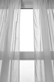 El venir ligero a través de la ventana Fotos de archivo