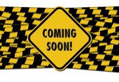 El venir pronto firma sobre las cintas de la barrera fotografía de archivo libre de regalías