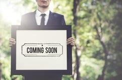 El venir pronto hace publicidad de concepto alerta del aviso Foto de archivo libre de regalías