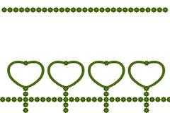 El verde deja el marco en forma de corazón Imagenes de archivo