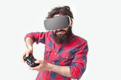 El videojugador en gafas de VR Imagenes de archivo