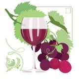 El vidrio de vino rojo, uvas, uva se va Foto de archivo