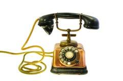 El viejo estilo, reviste el teléfono con cobre hecho Fotografía de archivo