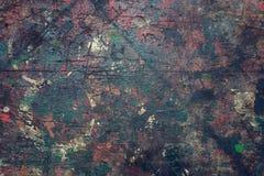 El viejo fondo de madera filtrado colorido de la textura salpicó con color Fotografía de archivo libre de regalías