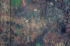 El viejo fondo de madera filtrado colorido de la textura salpicó con color Foto de archivo libre de regalías