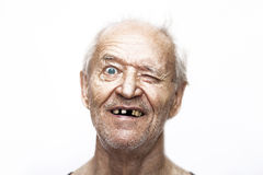 El viejo hombre bizqueado en sorpresa Imágenes de archivo libres de regalías