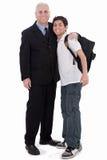 El viejo hombre de negocios abraza a un adolescente Fotos de archivo