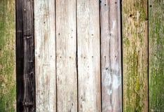 El viejo tablero de madera de la cerca pintó el fondo del vintage de la textura con los nudos Imagen de archivo libre de regalías