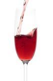 El vino a fluir en un vidrio Fotografía de archivo libre de regalías