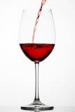El vino rojo salpica en un vidrio Fotografía de archivo libre de regalías