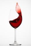 El vino rojo salpica en un vidrio Fotos de archivo libres de regalías