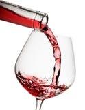El vino rojo vertió un vidrio Imágenes de archivo libres de regalías