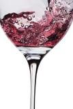 El vino se vierte en el vidrio Foto de archivo libre de regalías
