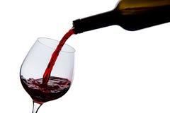 El vino se vierte en un vidrio Fotografía de archivo