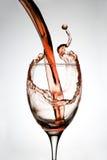 El vino vertió en el vidrio Fotografía de archivo