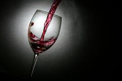 El vino vertió en un vidrio Fotos de archivo libres de regalías