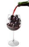 El vino vertió en el vidrio Imagen de archivo libre de regalías