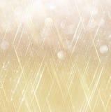 El vintage del brillo enciende el fondo Fondo abstracto del oro defocused