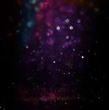 El vintage del brillo enciende el fondo plata ligera, púrpura, azul, oro y negro defocused Imagen de archivo libre de regalías