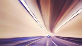 El vintage entonó la conducción de automóviles borrosa movimiento en túnel Fotografía de archivo libre de regalías